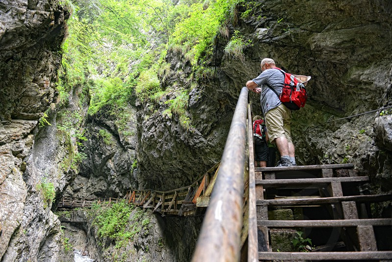 Stans Tirol/ AUSTRIA July 25 2016: people hiking through Wolfsklamm gorge canyon near Stans in Tirol Austria. Karwendel mountain alps. photo