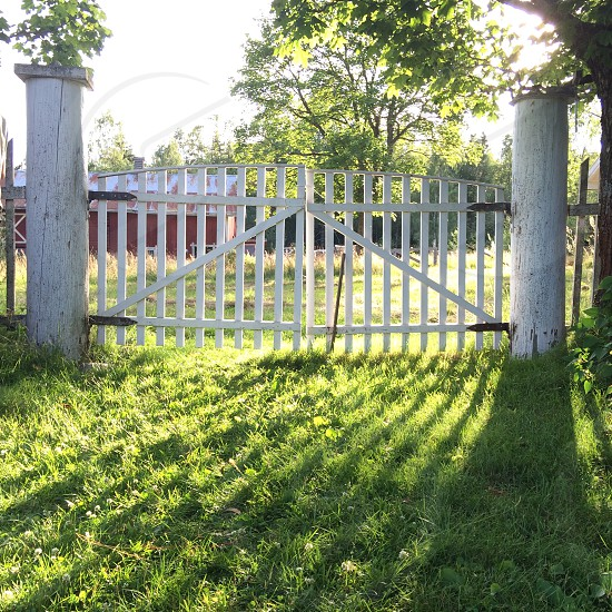 white wooden fence gate photo
