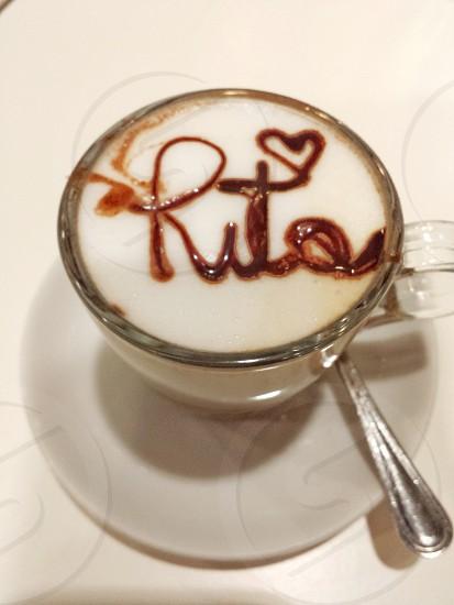 espresso with lettering of rita on white ceramic mug photo