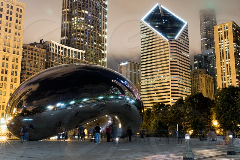 The Cloud gate sculpture in Chicago at night. photo