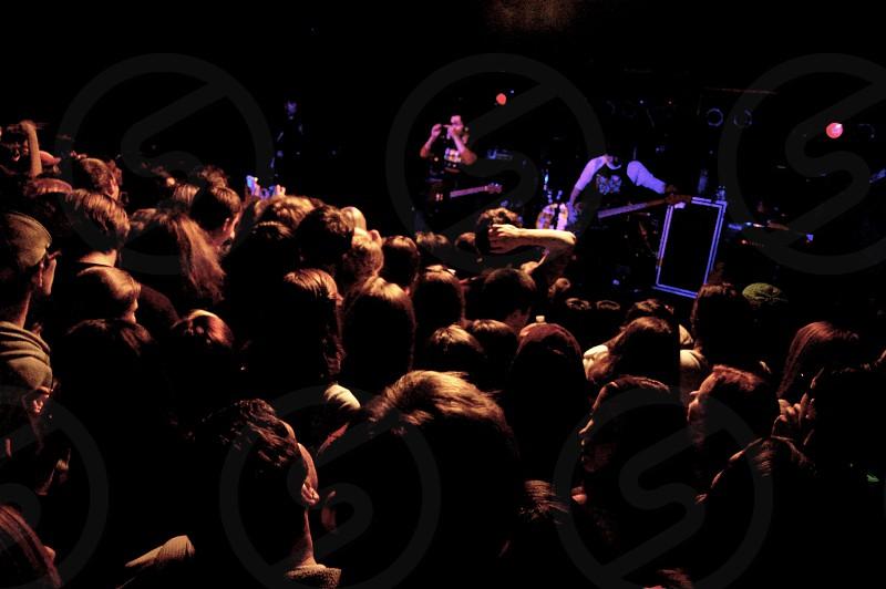 Fans enjoying a small concert photo