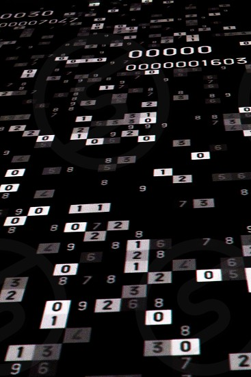 Numbers and mathematical codes shown on a dark background. photo