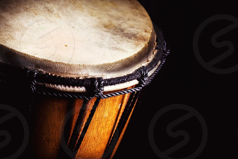 Closeup view of wooden djembe accentuated shapes.  photo