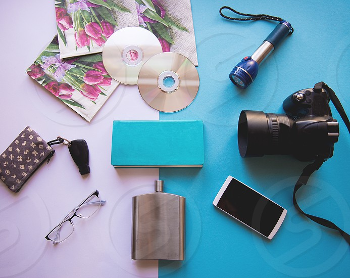 Flat lay of travel concept on whiteblue and yellow background photo