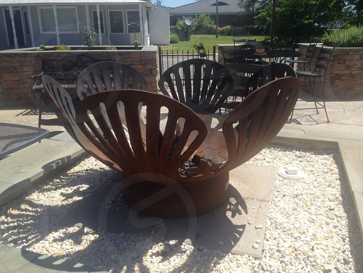 brown metal flower designed fire pit photo