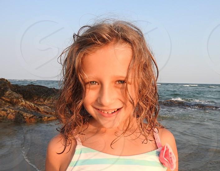 Summer; child; kid; beach; portrait; ocean; beauty; innocence; cute; outdoors  photo