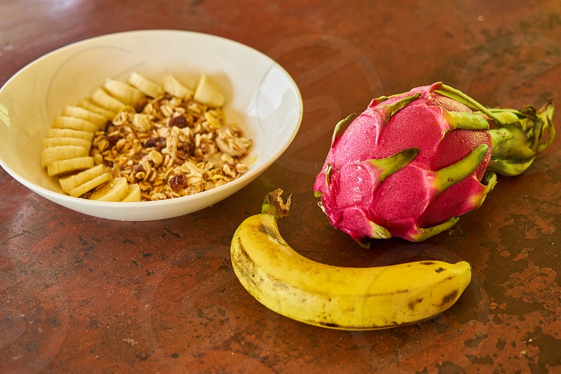 Morning oatmeal with banana on and dragon fruit photo