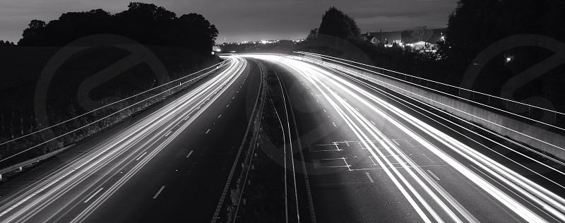black and white road night view photo