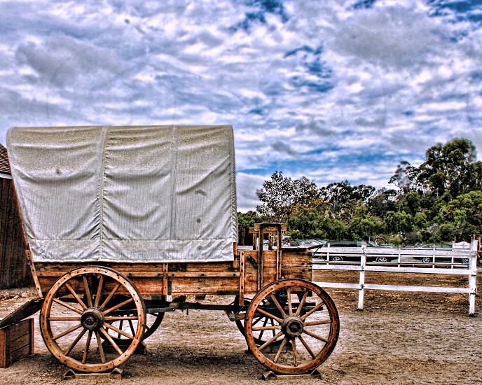 Wooden western Conestoga wagon used by the pioneers photo