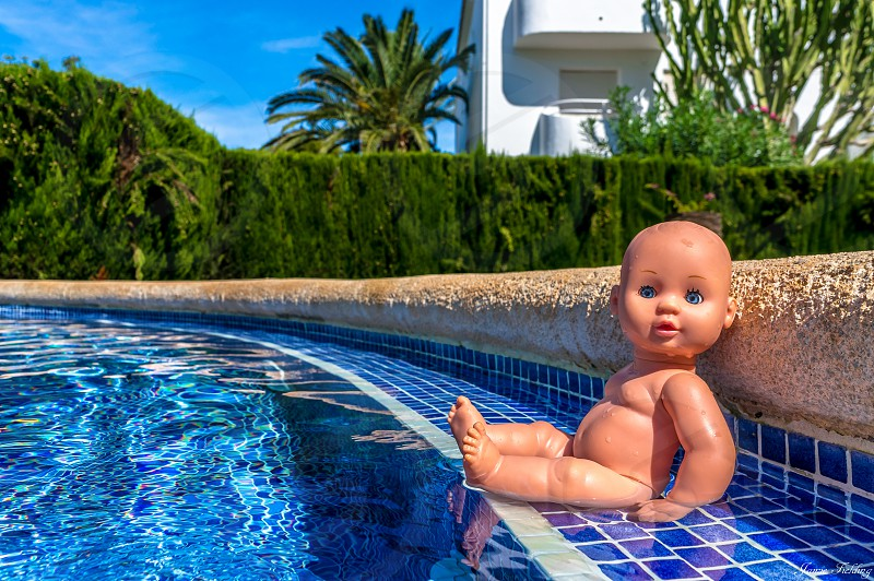 Surreal fun baby baby doll doll pool water swimming holiday poolside  photo