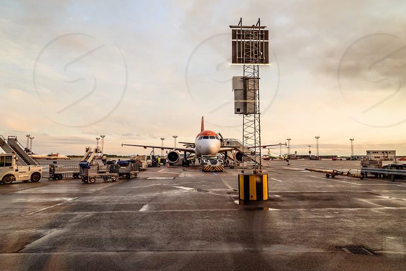 Passengers boarding a plane in Copenhagen airport. Near sunset photo