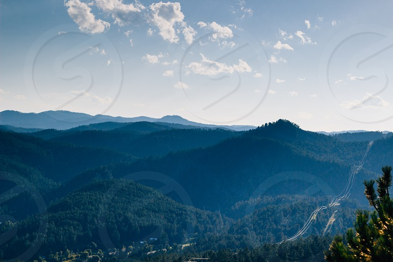 telephone lines running through the hills photo