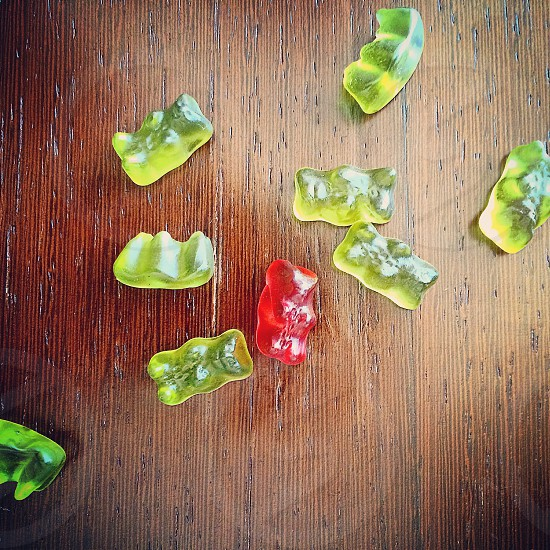 red and green gummi bears on the table photo