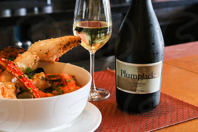 Cioppino and Plumpjack wine -- low profile horizontal photo