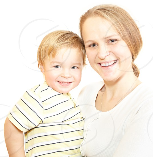 Young mother with her son smiling to the camera. Isolated on white. photo