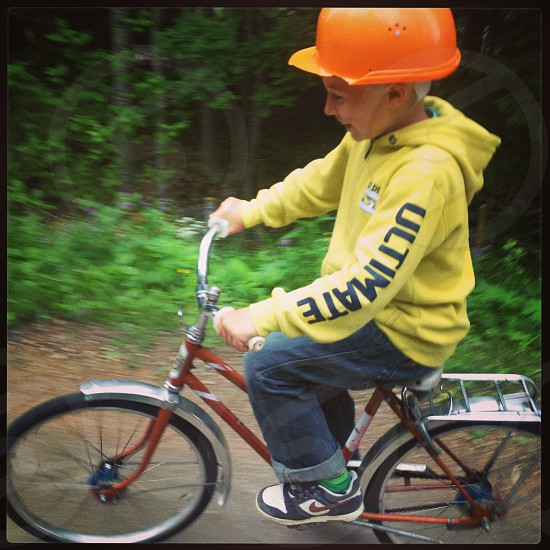 Boy Bicycling happy times in Dalarna Sweden photo