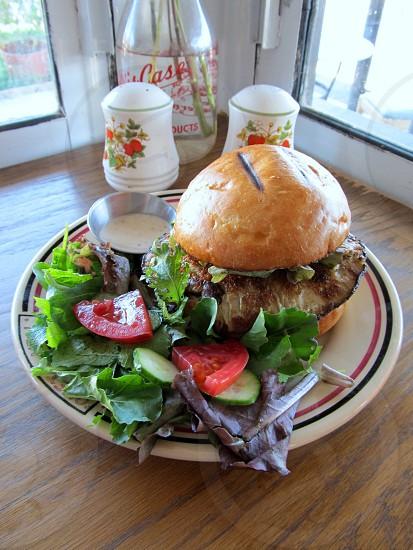 Portabello mushroom burger with salad photo