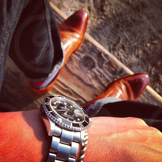 man wearing silver rolex analog wristwatch photo