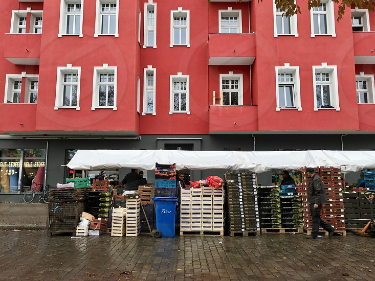 BerlinGermany Europe market pallets heap vegetable  fruit product merchant  street outdoor people photo