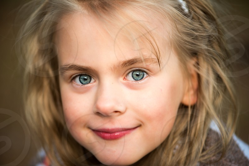 Close up portrait of beautiful little girl photo