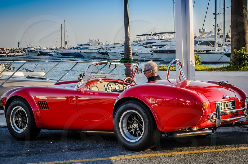 Red Shelby Cobra Sports Car parked at Puerto Banus Marbella - Spain photo