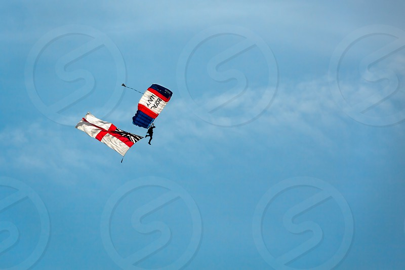 A Member of the Royal Navy Raiders Trailing the White Ensign photo