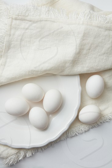 Easter eggs on white plate with napkin photo