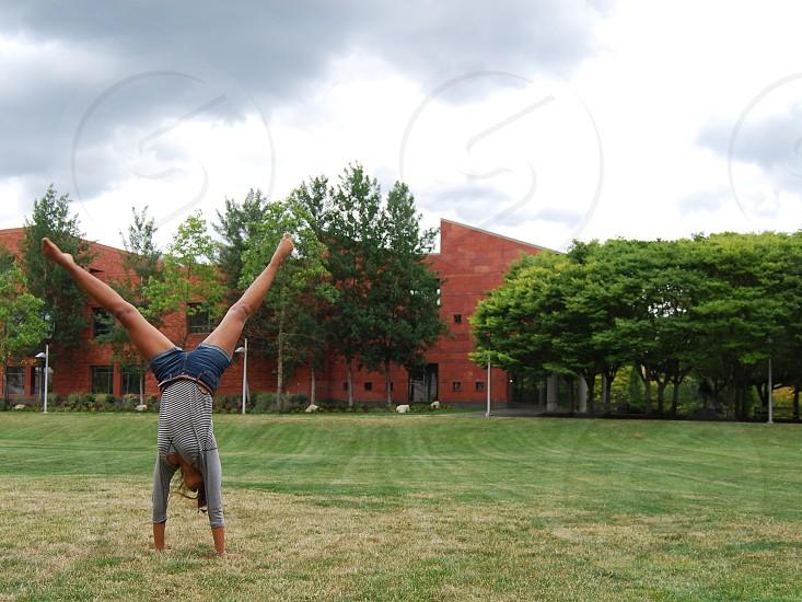 mid-cartwheel photo