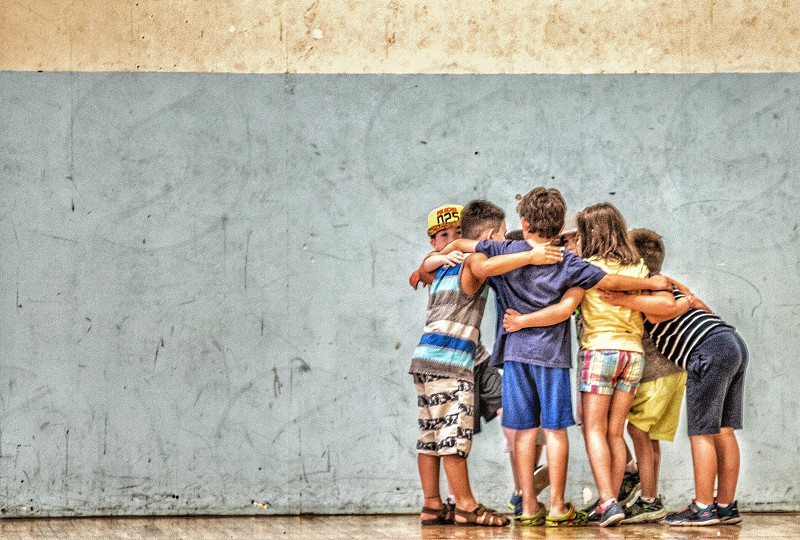 Children huddle friends photo