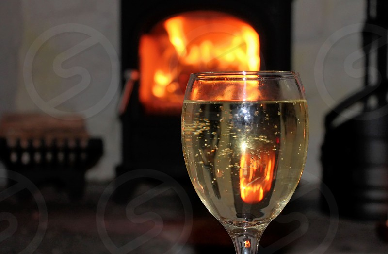 A glass of wine by the fire photo