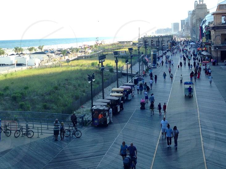 people walking along sidewalk photo