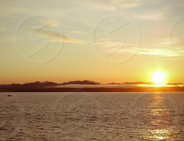 sun rising up photo