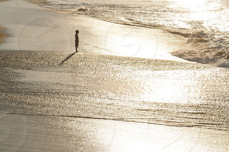child boy beach reflection minimal photo