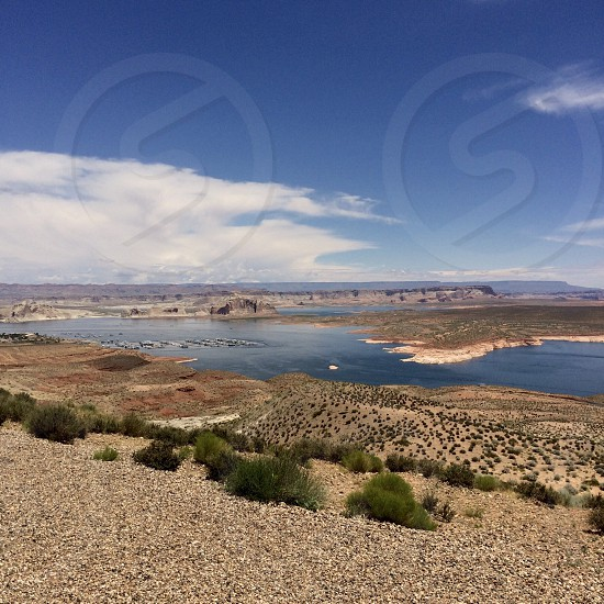 Lake Powell Utah Arizona Usa lake arid sky clouds landscape harbor boats water landmark artificial lake day outdoors fair weather  photo
