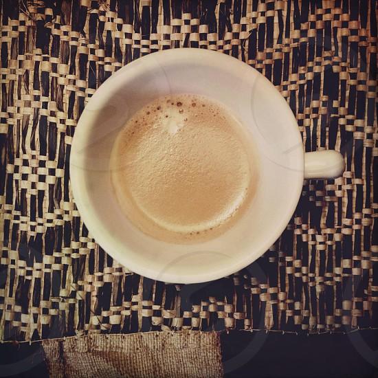 white ceramic mug high angle photo photo