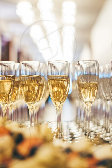 Close up view of glasses filled with champagne at festive photo