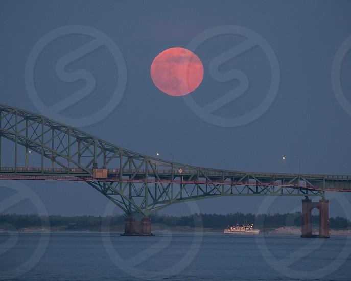 Full moon rising over Fire Island inlet bridge  Long Island NY photo