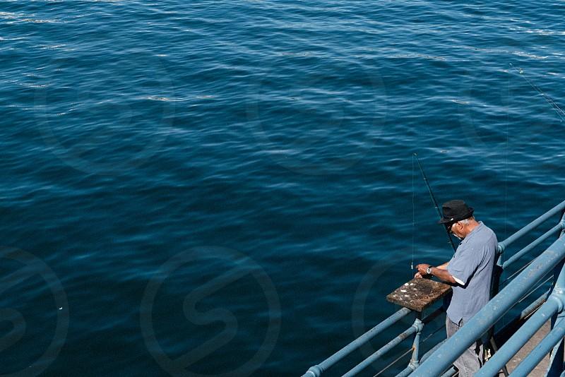 Old man fishing photo