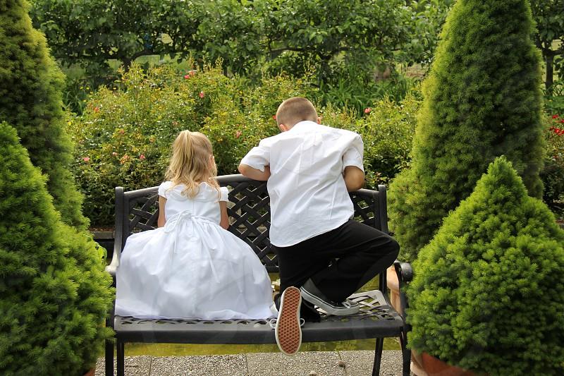 ring bearer flower girl girl boy park bench wedding friends children kids boyfriend girlfriend  photo