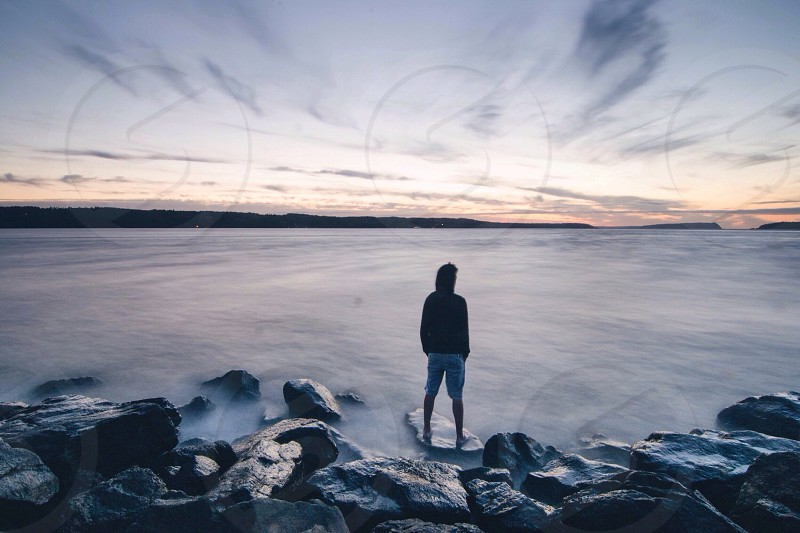 man standing on water photo