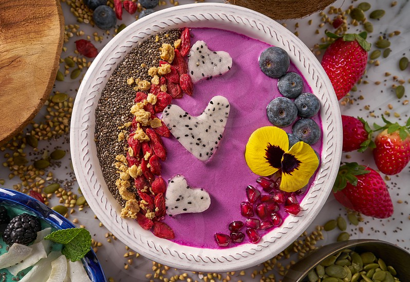 Acai bowl smoothie pitaya hearts blueberry goji chia pomegranate and seeds for Valentines day photo