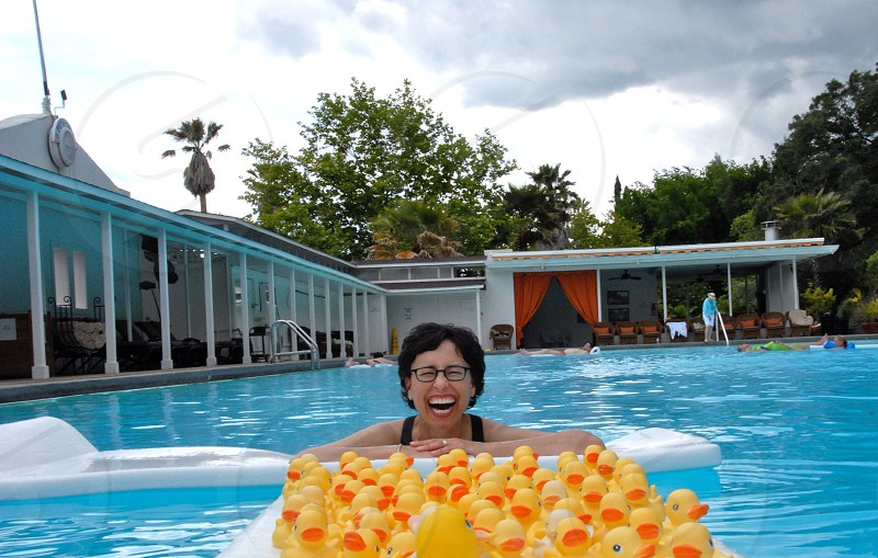 yellow rubber duckies in front of woman photo