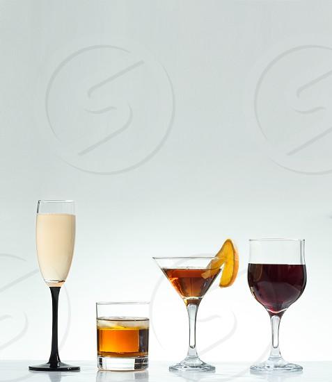 """Hero: shot of champagne whiskey cocktail wine photo"