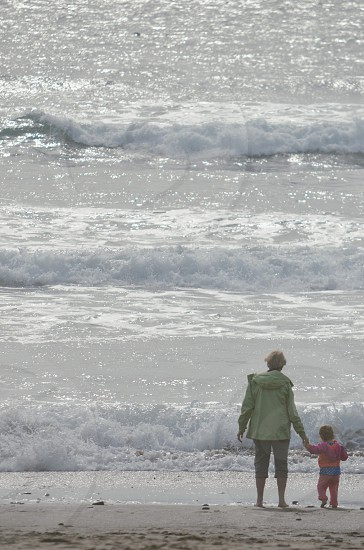 Mother's Day mother child toddler beach ocean holding hands photo