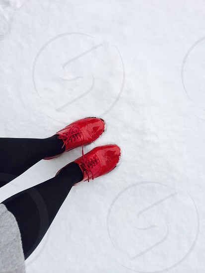 woman wearing red shiny shoes photo
