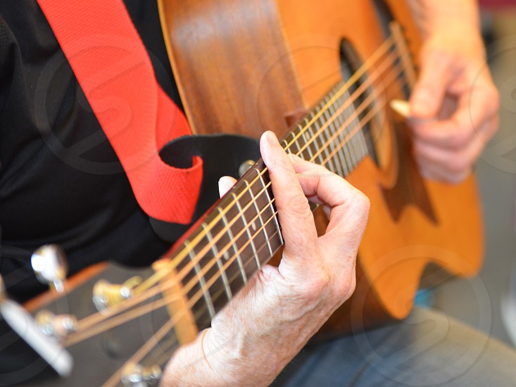 Guitar music musician hand strings playing instrument pick  photo