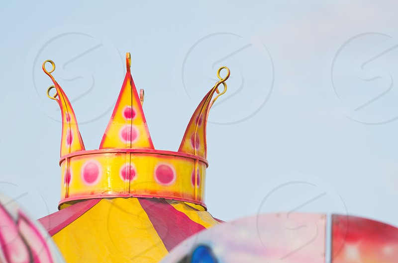 Fabulous Yellow Metal Crown Decoration Outdoors with Clear Blue Sky photo