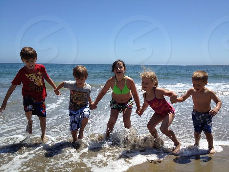 children on seashore photo