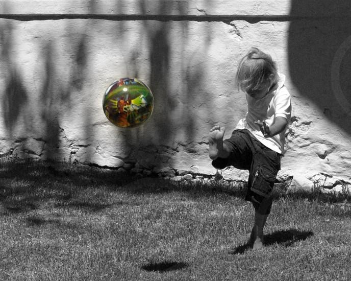 Kid playing soccer photo