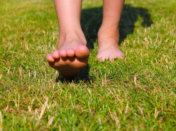Barefoot lawn walking photo